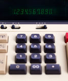 Old calculator for doing office related work Stock Photo