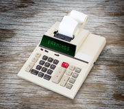 Old calculator - earnings Stock Photo