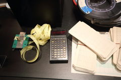 Old calculator with punched tape and magnetic tapes Stock Photography