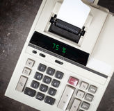 Old calculator showing a percentage - 75 percent Royalty Free Stock Photography