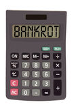 Old calculator on white background showing text. Bankrot on display of an old calculator on white background Royalty Free Stock Photos