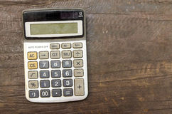 The Old calculator on wooden table Stock Photo