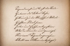 Old calligraphic manuscript. Vintage paper texture Stock Photography