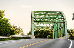 Old camel-back metal green bridge Royalty Free Stock Photo