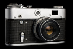 Old camera. Old used film camera isolated over black Royalty Free Stock Photos