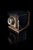 The old camera. An old camera with a black background Royalty Free Stock Images