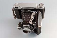 Old camera. Vintage camera with rangefinder and bellows stock image