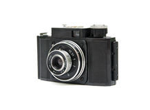 Old camera. Old 35 mm camera in black on a white background Stock Image