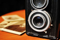 Old camera. Medium format twin-lens reflex cameras and three daguerreotypes. The daguerreotype was the first commercially successful photographic process stock images