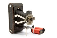 Old camera. And a roll of film Royalty Free Stock Image