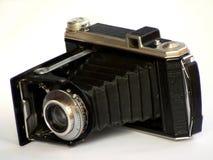 Old camera. Old vintage black pocket camera Stock Image