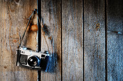 Old camera. On weathered wooden background royalty free stock photography