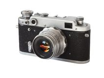 The old camera. Photo old Soviet Range finder the film camera on white a background Royalty Free Stock Photo