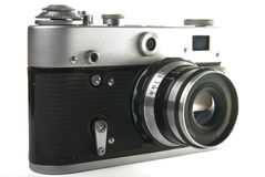 Old camera. There is a old camera on the white background Stock Photography