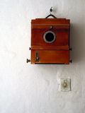 Old camera. A old photo camera on a white wall Royalty Free Stock Photos