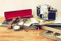 Old camera, antique photographs and old pocket clock. Royalty Free Stock Images