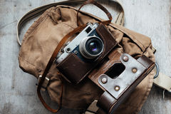 Old camera in bag, vintage photo grunge design component Stock Photo