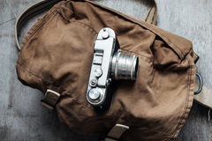 Old camera in bag, vintage photo grunge design component Stock Photography