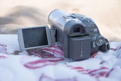 Old camera on the beach on a summer day royalty free stock image