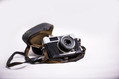 Old camera with a belt. stock photo