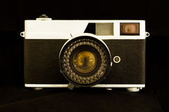 Old Camera. Old camera on black background Royalty Free Stock Photos