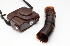 Old camera and blank film roll Royalty Free Stock Photos
