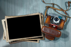 Old Camera and Blank Photo Frames Royalty Free Stock Image