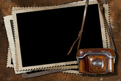 Old Camera and Blank Photo Frames Stock Photo