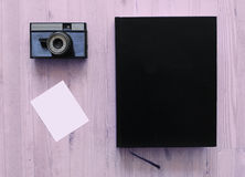 Old camera and book Royalty Free Stock Photos