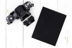 Old camera and book. royalty free stock photo