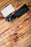 Old camera and book on wooden desk, travel, tour, tourism concept,Top view, Free space for design Stock Images