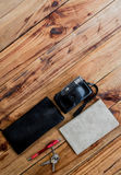 Old camera and book on wooden desk, travel, tour, tourism concept,Top view, Free space for design Royalty Free Stock Images
