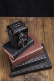 Old Camera On Books Stock Photography