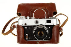 Old camera. With a brown leather cover isolated on white background Stock Photo