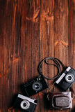 Old camera on a brown wooden background. Four old camera lies on a brown wooden background royalty free stock image