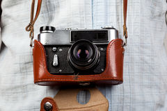Old camera in case. Retro film camera in leather case Royalty Free Stock Photography