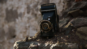 Old Camera. On a destroyed Wall stock image
