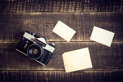 Old camera with empty photographs Stock Photos