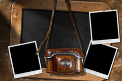 Old Camera with Empty Photos and Blackboard Royalty Free Stock Photography