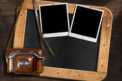 Old Camera with Empty Photos and Blackboard Royalty Free Stock Photo