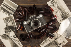 Old camera, film and black and white photographs are on the dark Royalty Free Stock Images