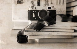 Old camera, film, books Royalty Free Stock Photos