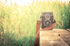 Old camera. Old film camera in a field royalty free stock photo