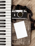Old camera, film, piano Stock Photography