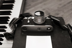 Old camera, film, piano Royalty Free Stock Image