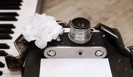 Old Camera, Film, Piano, White Flower Royalty Free Stock Photography
