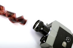Old camera and film strip Royalty Free Stock Images
