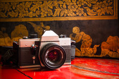 Old camera film in temple Royalty Free Stock Images