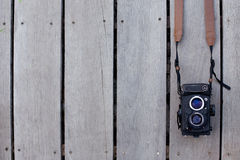 Old camera. Film camera is old on wooden background. Camera is 35mm and twin-lens reflex. Vintage or retro style stock photo
