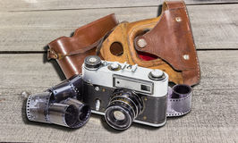 Old camera and films Royalty Free Stock Images
